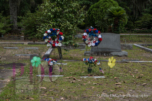 Patriotic flowers adorn graves at Bonaventure. This is the only image I could get with the wind blowing. It was still the rest of the time there.